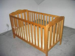 Wooden baby crib / bed with mattress and sheets - $145
